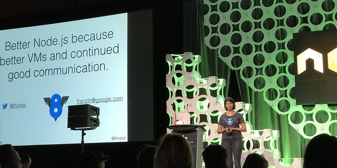 """Photograph of Franziska Hinkelmann on Google, presenting on V8 and the future of Node.js. She is in front of a screen that reads: """"Better Node.js because better VMs and continued good communication."""""""