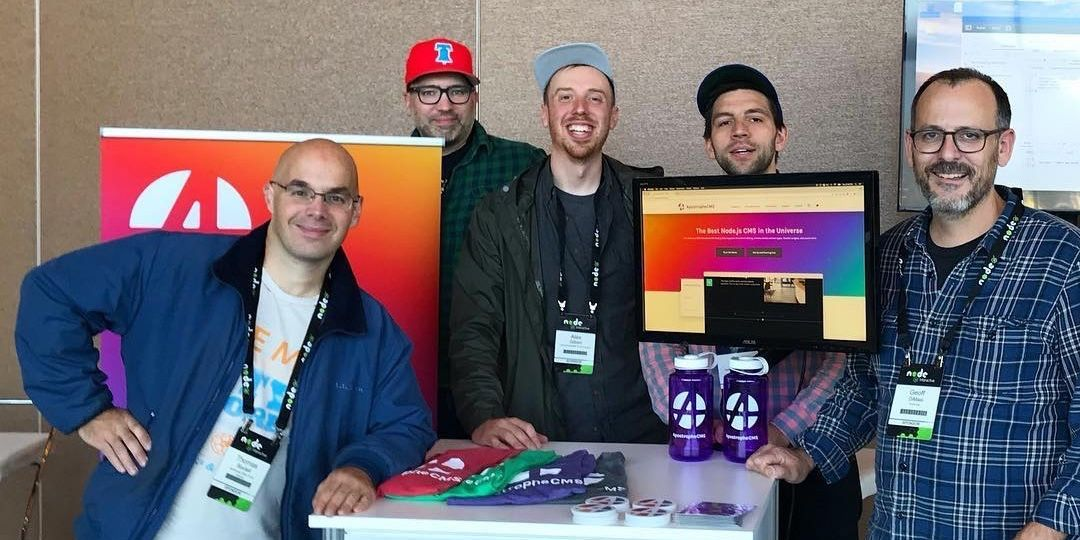 Tom Boutell, Alex Gilbert, Stuart Romanek, Bob Clewell, and Geoff DiMasi posing at the ApostropheCMS booth at NodeJS Interactive 2017
