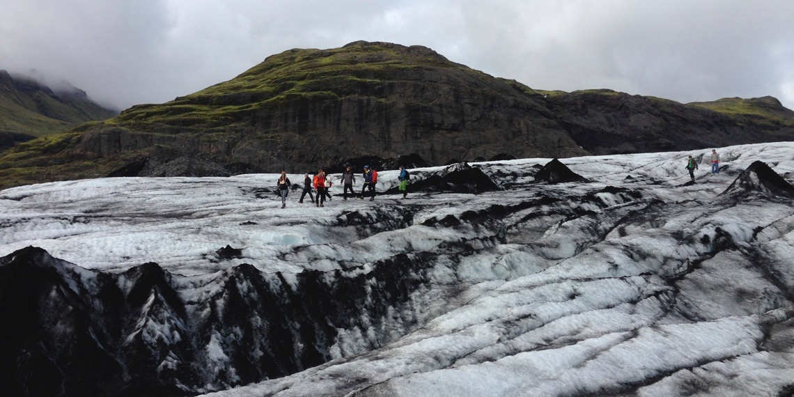 The Green Program case study: image of students in brightly-colored jackets on a glacier beneath a bright but cloudy sky