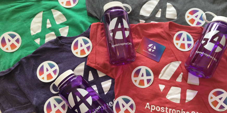 Photo of ApostropheCMS swag -- t-shirts, stickers, and nalgene bottles - for NodeJS Interactive 2017